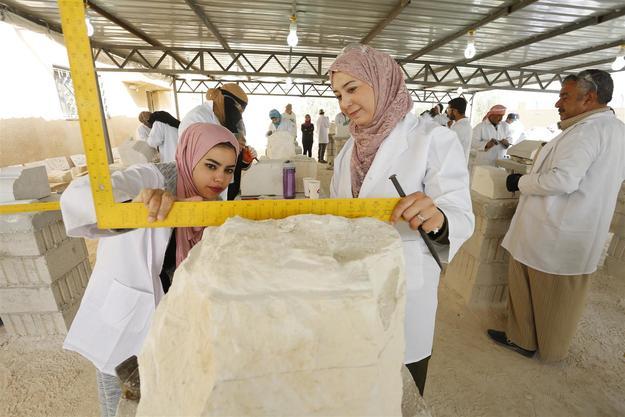 Students measuring stone block, April 2018