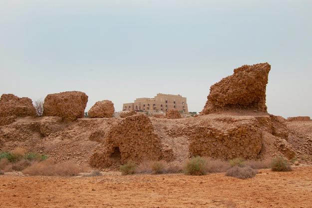 Nebuchadnezzar II's Northern Palace ruins with Saddam Hussein's modern palace in background, 2008