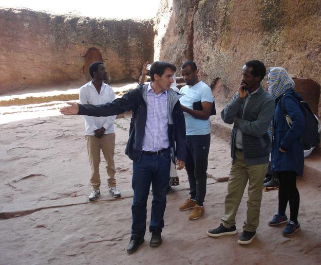 Students participating in the Lalibela field school, 2016, shown here listening to a presentation on the history of the site and WMF's project at Beta Maryam by WMF representative Stephen Battle. Photo: L. Gottert