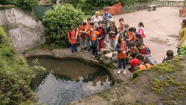 Local students visit the basin in teatro delle Fontane before conservation works begin, 2016