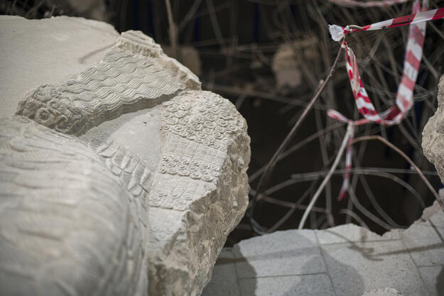 Fragment of a lamussu from Nimrud near the hole in the floor of the Assyrian Hall, Mosul Cultural Museum, September 2021. Photo credit: Ali Al-Baroodi and Moyasser Naseer.