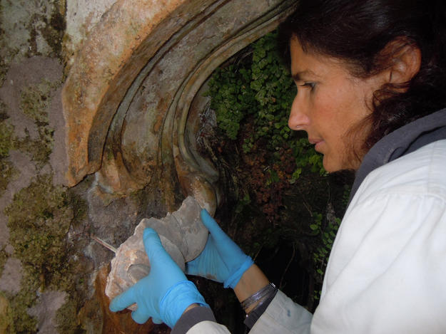 A conservator returns fountain to good repair, 2013