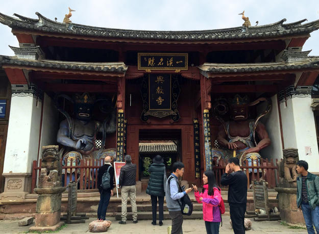 Visitors enjoy the Shaxi Temple after its conservation, 2015