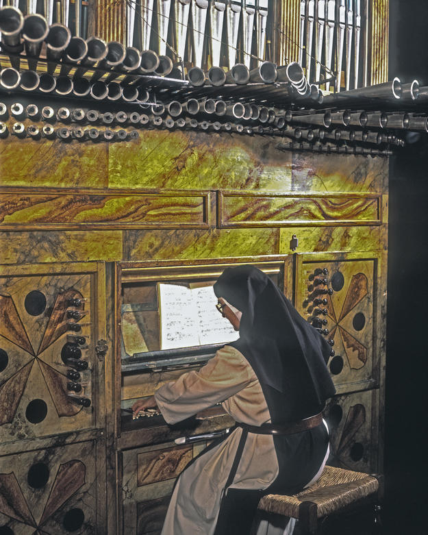 A nun playing the organ at the Convent of San Clemente, built over 700 years ago, 2003