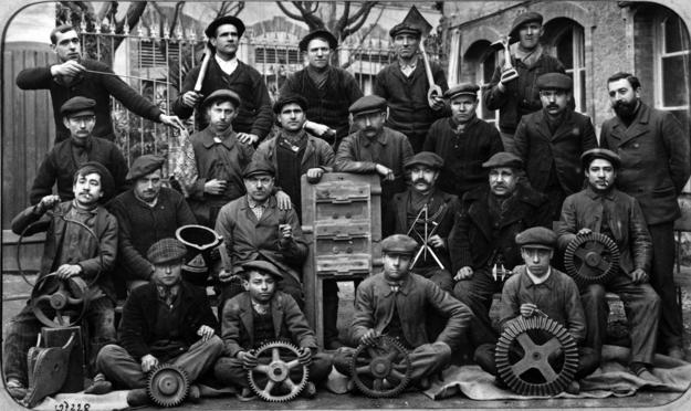A group photo of employees of Averly Foundry at the turn of the twentieth century, posing with the tools of their trade, ca. 1900