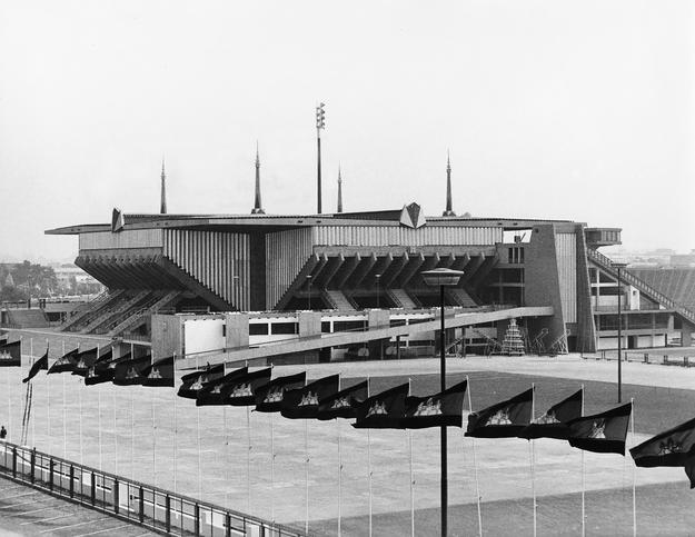 A historic view of the National Sports Complex from the southwest with row of flags of the Kingdom of Cambodia in the foreground, ca. 1964