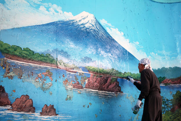 One of only two painters responsible for repainting bathhouse murals of Mount Fuji, 2019.