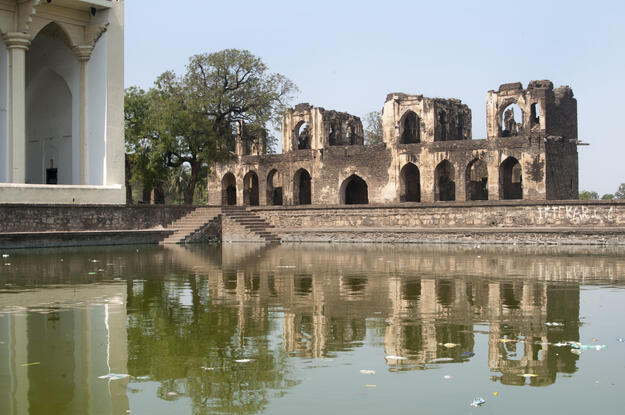 The ruins of the Jahaz Mahal, or Ship Palace, overlook the Asar Mahal pool. Photo credit: Joginder Singh.