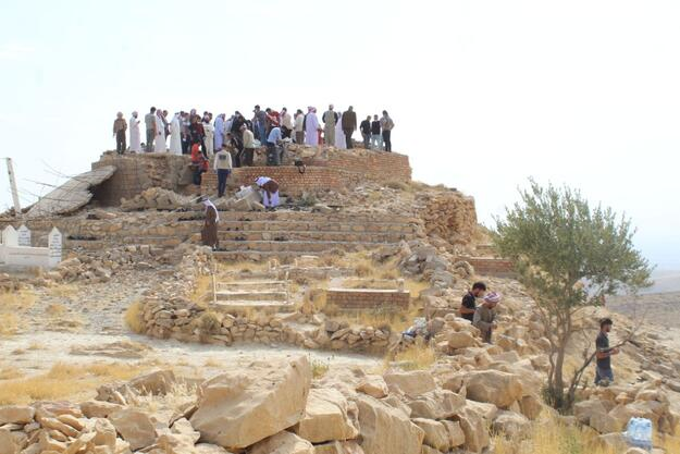 Yazidi religious authorities and community representative gathered at Mam Rashan for a blessing event. In this image, they stand on the terrace of the destroyed shrine. 2020.