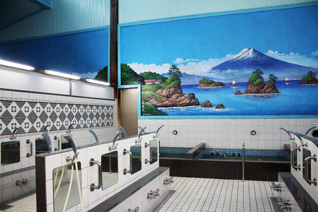 The large bathing area of Inari-yu bathhouse, with a mural depicting Mount Fuji, 2019.
