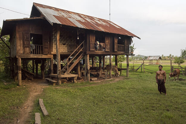 A teak house owner and his house in Mawlaik, 2017.