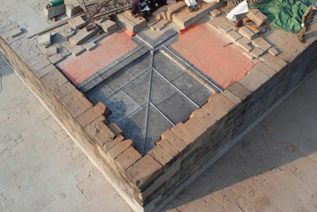 The waterproofing program used at Phnom Bakheng involves covering the foundation with a PVC membrane and, in some cases, an added layer of lead sheets.