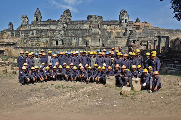 78 WMF workers pose in front of the temple of Phnom Bakheng in 2013