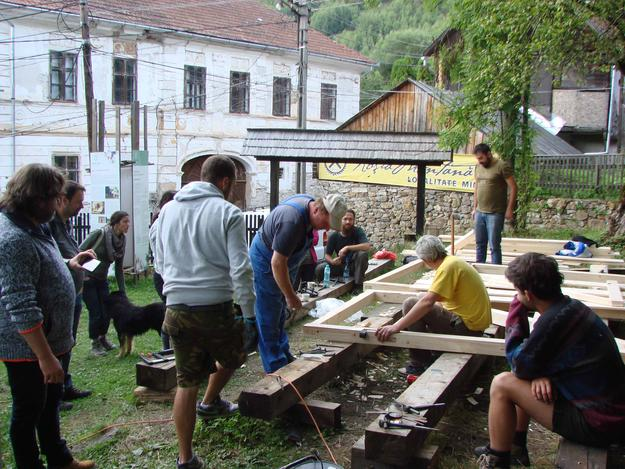 Building of wooden gate doors at the Unitarian parish house, part of a carpentry workshop during Heritage Week, 2016
