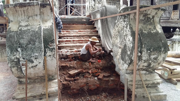 The southwest staircase steps, poorly rebuilt in the past with bricks, thin stone slabs, and cement stucco, in the process of being repaired with solid sandstone blocks, July 2016