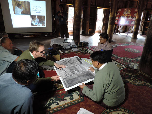 Former Minister of Culture U Aye Myint Kyu reviews laser scanning documentation of the Buddha throne with team members, January 2016
