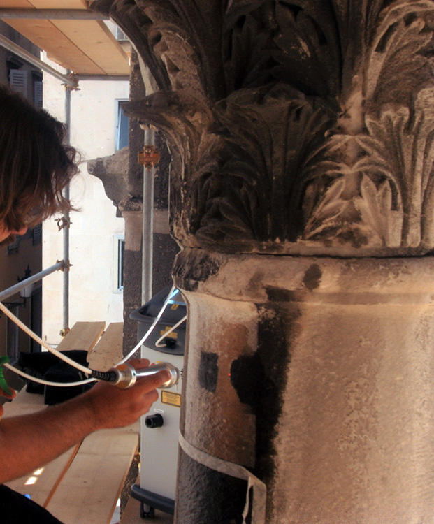 Conservators use a laser technique to clean the stone, 2003