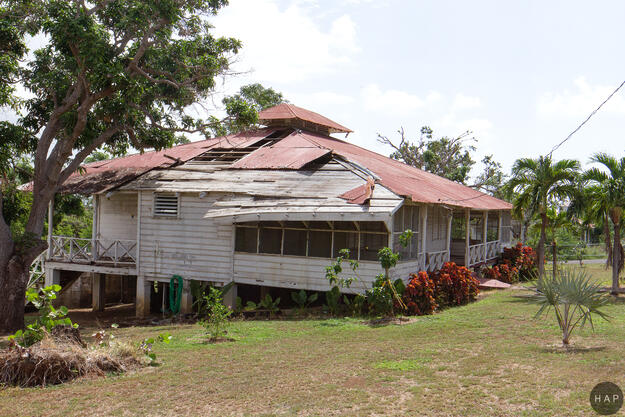 A house in the Central Aguirre Historic District following Hurricane Maria, 2017.