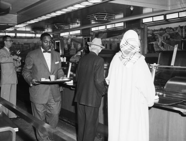 The Woolworth lunch counter in San Antonio was peacefully integrated, 1960. Photo courtesy San Antonio Express-News Photograph Collection, UTSA Archives Special Collections.