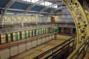 The first class gala pool, which has been closed since 2003 for safety reasons, with filigree cast iron arches and spectator galleries, 2013