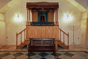 The new bima of the Etz Hayim Synagogue. The ehal and bima were reconstructed using a 400 year old cedar wood in a style mimicking the neoclassical pediment of the northern courtyard entrance with parallels those found in Izmir, Patras, and Corfiote synagogues of the same era. The synagogue was furnished so that it could again function as a place of regular Jewish worship., 1999