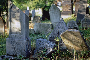 """First established in 1386, the cemetery was unused since the end of the seventeenth century, when the """"new"""" cemetery was opened. The old burial ground had become overgrown with vegetation and overcrowded with tombstones, many of them randomly scattered and broken., February 1975"""