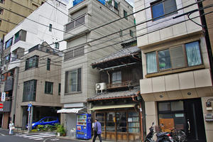 The Maeno merchant house, a traditional machiya building in Tsukiji, between buildings of more recent style, 2015