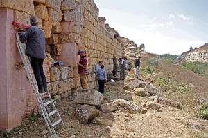 WMF and antiquities documenting sanctuary wall, August 20, 2013