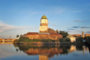 Vyborg Castle, a fortress originally dating from the thirteenth century, with the Vyborg Historic Center in the distance, 2014