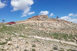 The Mam Rashan Shrine on Mount Sinjar, seen from below its promontory, 2019.