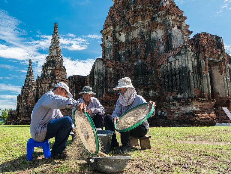 WMF technicians and conservators cleaning sand for mortar mixing at Wat Chaiwatthanaram.