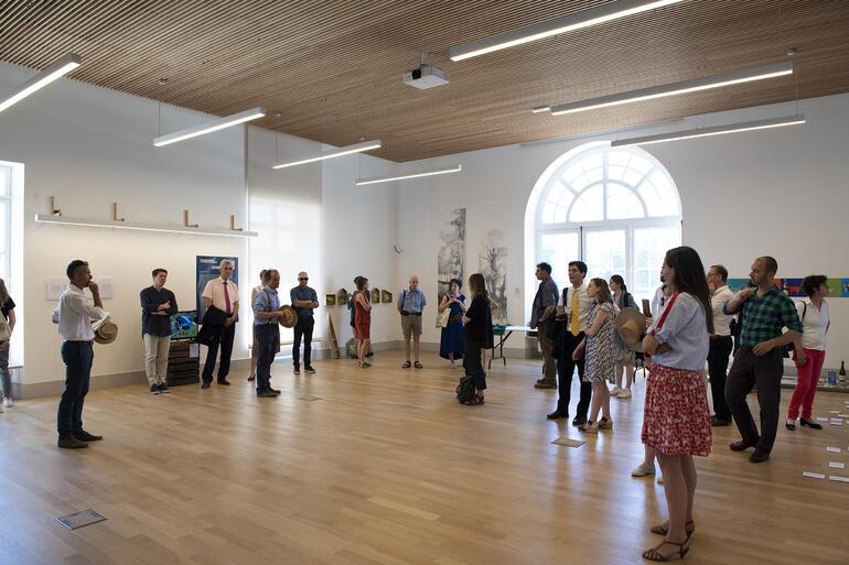 Visitors inside the exhibit Le Gout du Paysage at the Potager, 2019