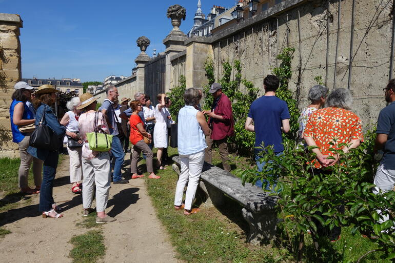 Visitors receiving an expert-led talk on the art of espalier, 2019.