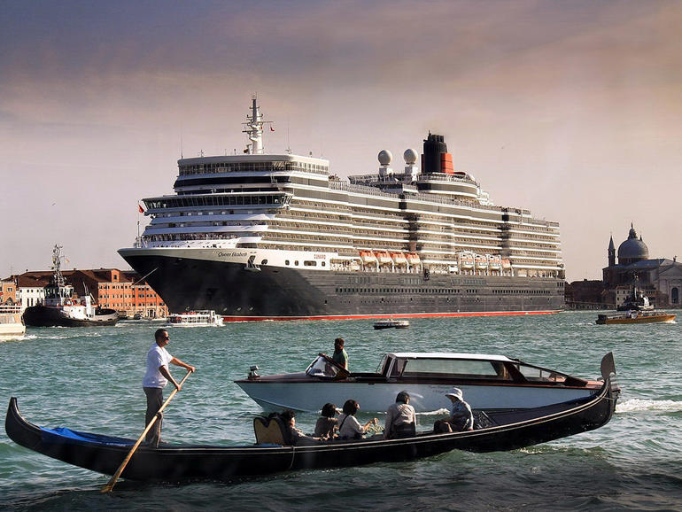 A cruise ships docks in the historic port, dwarfing the city and its famed gondolas, 2011