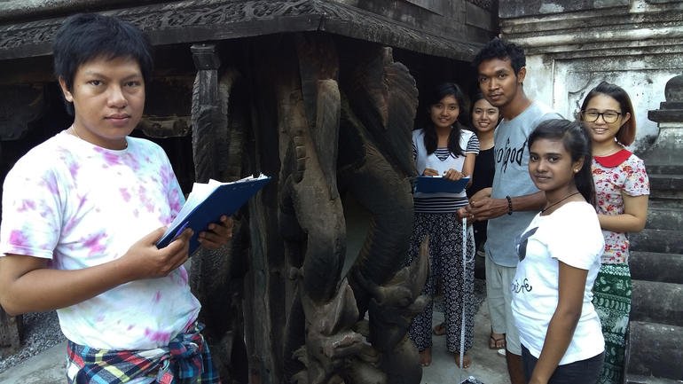 Local students help with documentation at Shwe-nandaw Kyaung, in Mandalay, Myanmar.