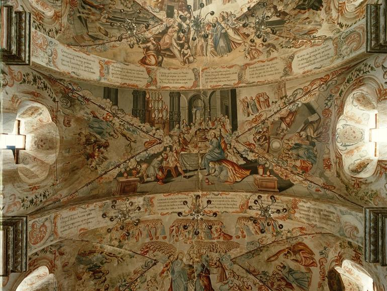 The richly decorated ceilings of the sanctuary depict scenes of the life of Jesus.
