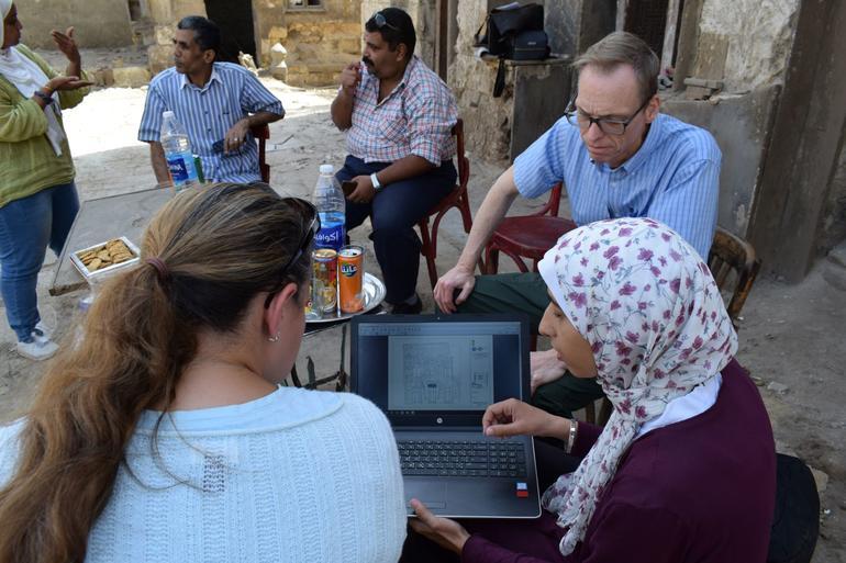 Heba Badr, right, reviews site plans for Takiyyat Ibrahim al-Gulshani.