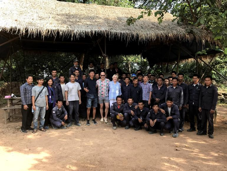 The team of skilled workers at Preah Khan with Joshua David and WMF chair Lorna Goodman, center, January 2018.