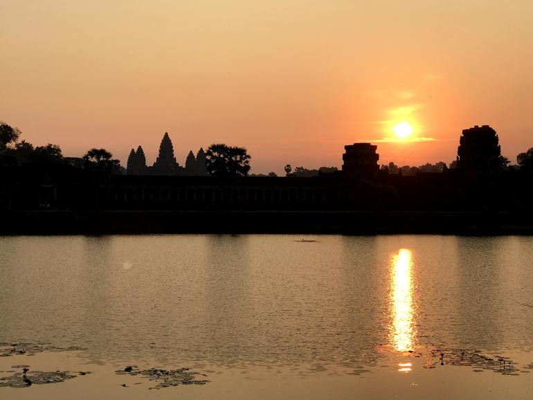 Sunset over Angkor Archaeological Park in Siem Reap, Cambodia, January 2018.