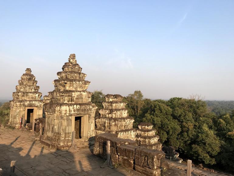 Stone shrines dot Phnom Bakheng.