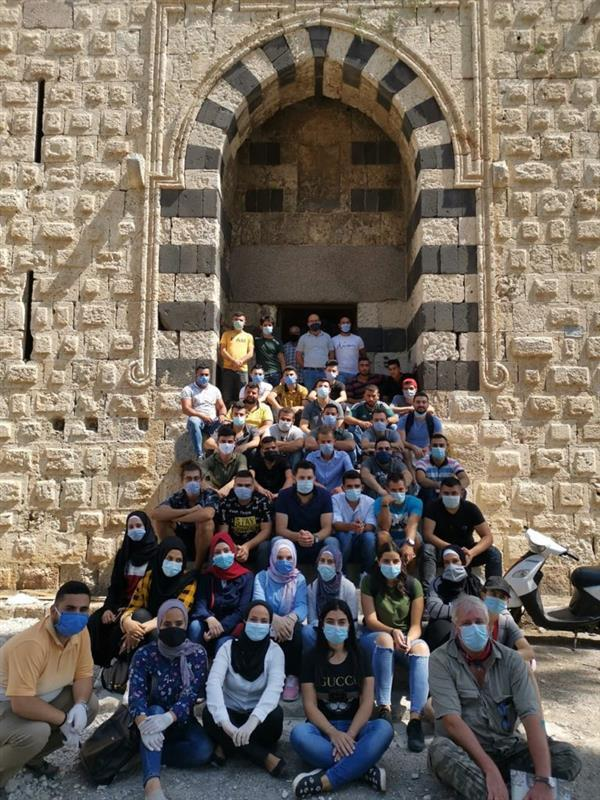 Group photo of trainees in front of the Lion Tower in Tripoli, Lebanon, 2020.