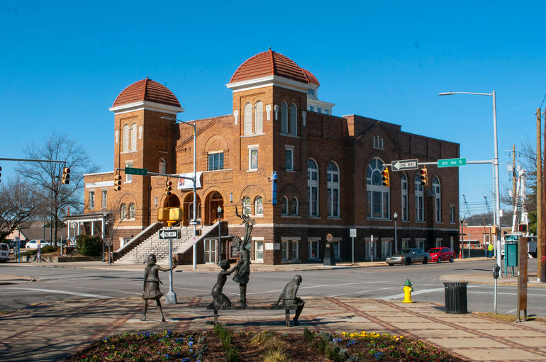 "Sixteenth Street Baptist Church and in the forefront, the ""Four Spirits"" memorial that remembers the four young girls murdered at the church. Photo by Billy Brown."