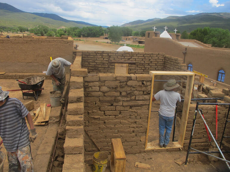Building reconstruction at Taos Pueblo, 2011.