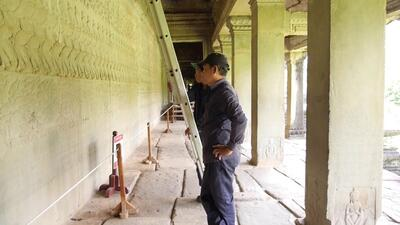 Studying the Churning of the Sea of Milk Gallery at Angkor Wat
