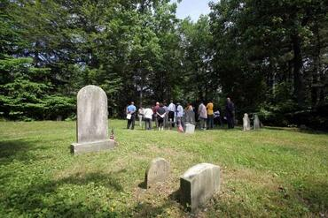 View of a gathering at the Rye African-American Cemetery.