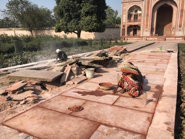 Conservation technicians work on the pathways and water channels of the northern boundary wall of I'timad-ud-Daulah.