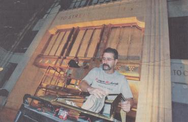 Marty Slawiak is captured by a local newspaper installing lighting in Buffalo Central Terminal.