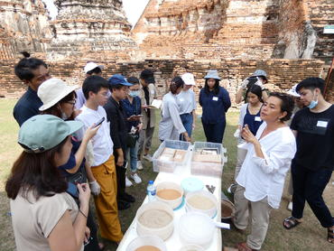 Students being led on conservation techniques at Wat Chaiwatthanaram