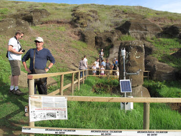 Tourists visit an excavation site on Rano Raraku, 2011